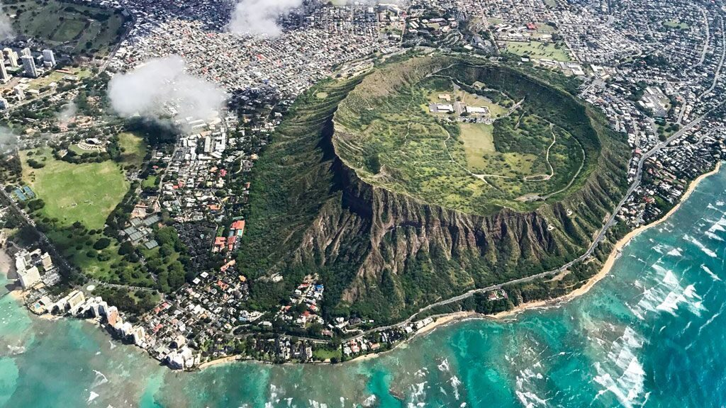 Flying over Diamond Head on airfare to Hawaii from Panda Travel.